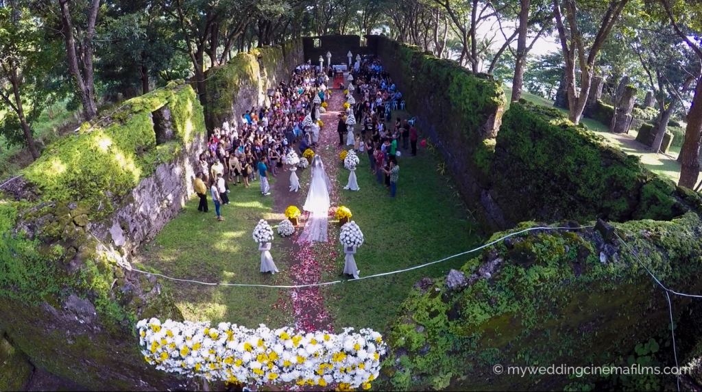 The Bride down the isle at the OLD CHURCH RUINS in Camiguin.